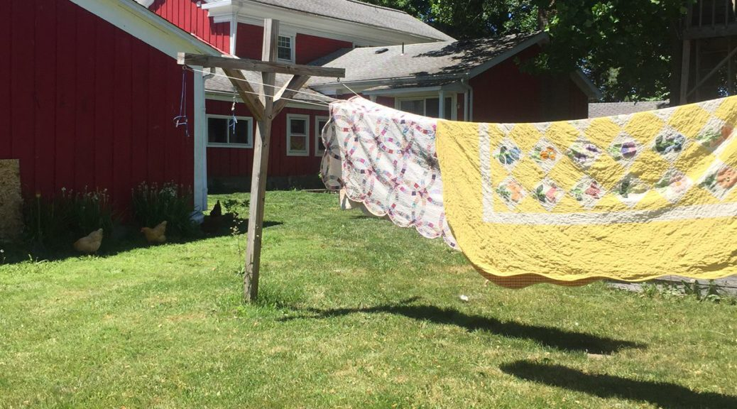 Quilts drying outside | Little Red Farmstead