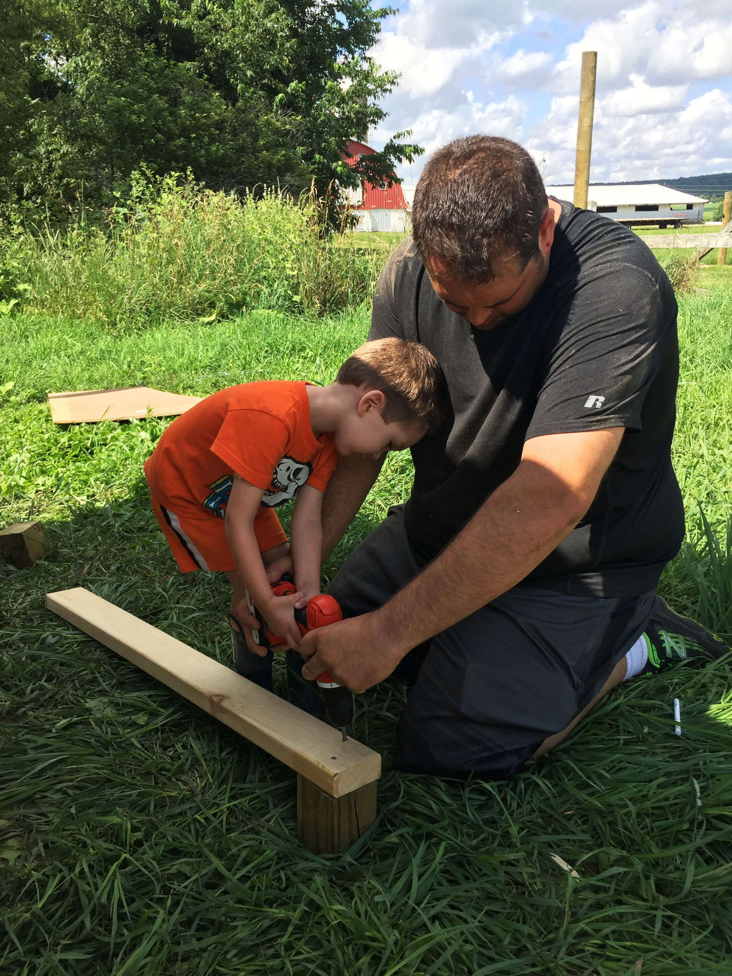 Myles helping Daddy build